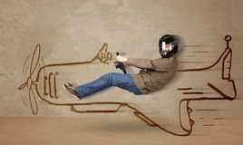Funny pilot driving a hand drawn airplane on the wall Stock Images