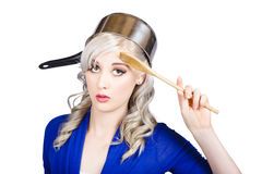 Funny pin up housewife saluting for cooking duties Royalty Free Stock Photos