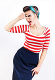 Funny pin-up woman with fingers on eyes Royalty Free Stock Photos