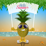 Funny pineapple with sunglasses on the beach Stock Images