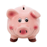 Funny pink piggy bank isolated over white Royalty Free Stock Images