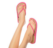 Funny pink sandals on female feet. Isolated on white background Royalty Free Stock Image