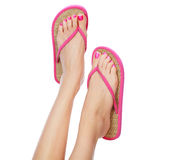 Funny pink sandals on female feet. Isolated on white background Royalty Free Stock Photos