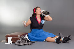 Sitting pinup girl drinking champagne Royalty Free Stock Photo
