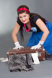 Funny pinup girl with overfilled suitcase Stock Image