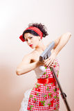 Funny pinup using vacuum cleaner as microphone Stock Image
