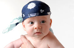 Funny pirat. Baby with head cloth Royalty Free Stock Photography