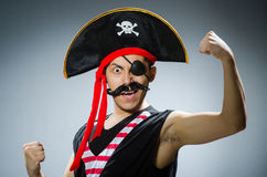 Funny pirate. In the dark studio Stock Image