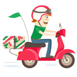 Funny pizza delivery boy riding red motor bike wearing uniform a Royalty Free Stock Photo