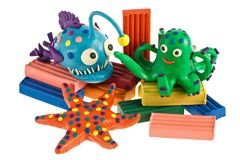 Funny plasticine animals. Anglerfish, Octopus and Sea Star royalty free stock photo