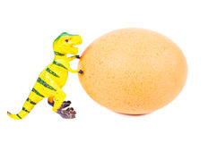 Funny plasticine dinosaur toy and egg. Stock Photos