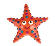 Funny plasticine Starfish. Funny Starfish made of plasticine Royalty Free Stock Image