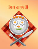 Funny plate. Funny face,plate with eggs slice of carrot and peas,napkin,fork,knife Royalty Free Stock Images
