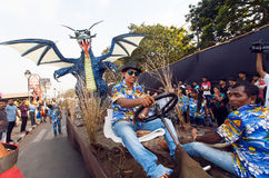 Funny platform with blue dragon driving on the crowded street during the traditional Goa carnival Stock Photography