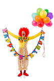 Funny playful clown. In red wig holding balloons and Happy Birthday garland, looking at camera and smiling, isolated on a white background Royalty Free Stock Photos