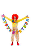 Funny playful clown. In red wig holding Happy Birthday garland, looking at camera and smiling, isolated on a white background Royalty Free Stock Photos