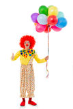 Funny playful clown. In red wig showing OK sign, holding balloons, looking at camera and smiling, isolated on a white background Stock Photography