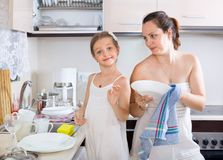 Funny playful girl helping mother Royalty Free Stock Image