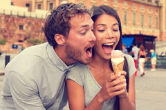 Funny playful young couple eating ice cream Royalty Free Stock Image