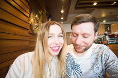 Funny playful young couple making silly face.  Stock Photography