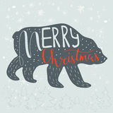 Funny polar bear with quote Merry Christmas on snowy background. Royalty Free Stock Photos
