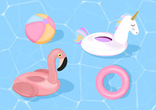 Funny pool floats with flamingo and unicorn. Vector illustration. Pool toys on blue sea background. Royalty Free Stock Photo