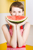Funny woman with juicy fruit smile Stock Photography
