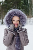 Funny portrait of beautiful woman on winter walk Royalty Free Stock Image