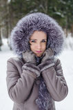 Funny portrait of beautiful woman on winter walk Stock Images