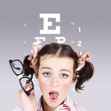 Vision impaired woman at optometrist Stock Photo