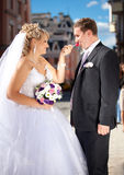 Funny portrait of bride giving lollipop to groom Stock Photography