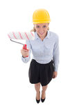 Funny portrait of business woman in builder helmet with paint br Royalty Free Stock Photos