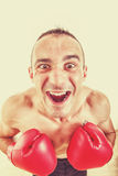 Funny portrait of a confused and astonished man with red boxing Royalty Free Stock Image