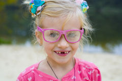 Funny portrait of emotional girl in pink glasses Stock Image