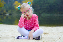 Funny portrait of emotional girl in pink glasses Royalty Free Stock Images
