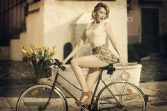 Funny portrait of girl on bicycle Stock Photos