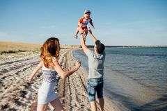 Funny portrait of a happy family on the beach royalty free stock photos