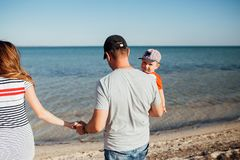 Funny portrait of a happy family on the beach stock image