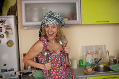 Funny portrait of the housewife in the kitchen Stock Images