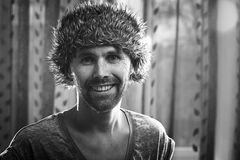 Funny portrait of a man in  fur hat Royalty Free Stock Photography
