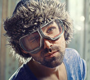 Funny portrait of a man in  fur hat Royalty Free Stock Photos