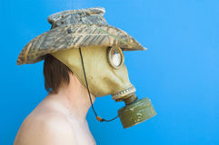 Funny portrait of man with gas mask and hat Royalty Free Stock Image