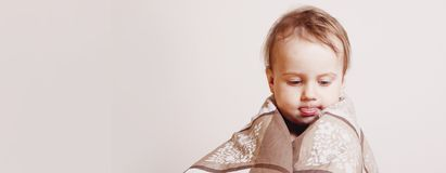 Funny portrait of sleepy cute little child girl before bedtime.  royalty free stock image
