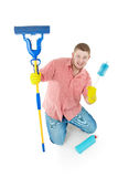 Funny portrait of standing cleaner. Iisolated over white Royalty Free Stock Images