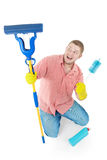 Funny portrait of standing cleaner. Picture of joyful  professional cleaner. Iisolated over white Royalty Free Stock Images