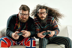 Funny portrait of two best friends playing games. Funny portrait of two best friends playing console Stock Images