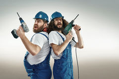 Funny portrait of two craftsmen Stock Photos