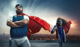 Funny portrait of two super heroes. Funny portrait of two antagonistic super heroes stock photo