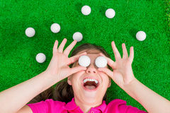 Funny portrait  of a woman with golf balls Stock Photos