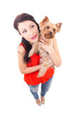 Funny portrait of woman holding little dog Royalty Free Stock Image